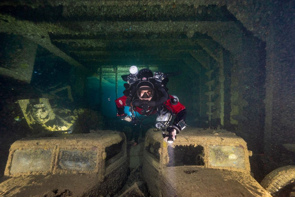 Inside of the SS Thistlegorm shipwreck with scuba diver. Photo by Kees Beemster Leverenz.